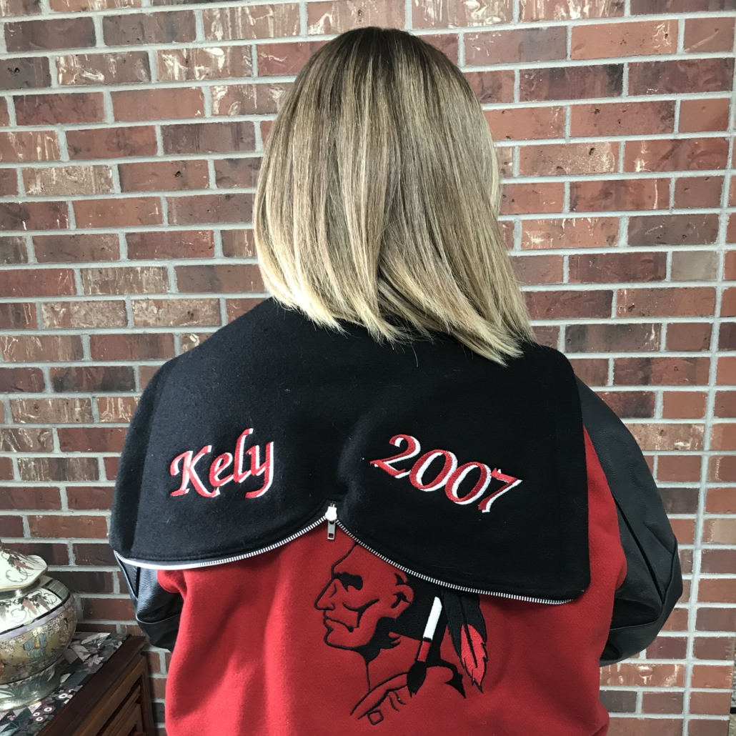 A photo of my high school letter jacket with my name spelled K-E-L-Y